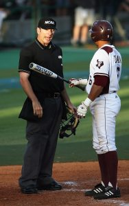 Baseball player arguing with umpire