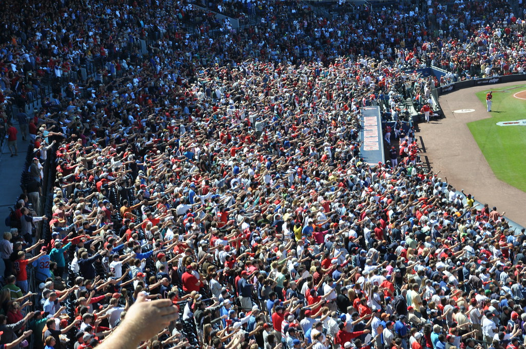 Atlanta Braves fans doing the tomahawk chop in the stands